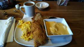Catfish, eggs, grits, toast, and coffee
